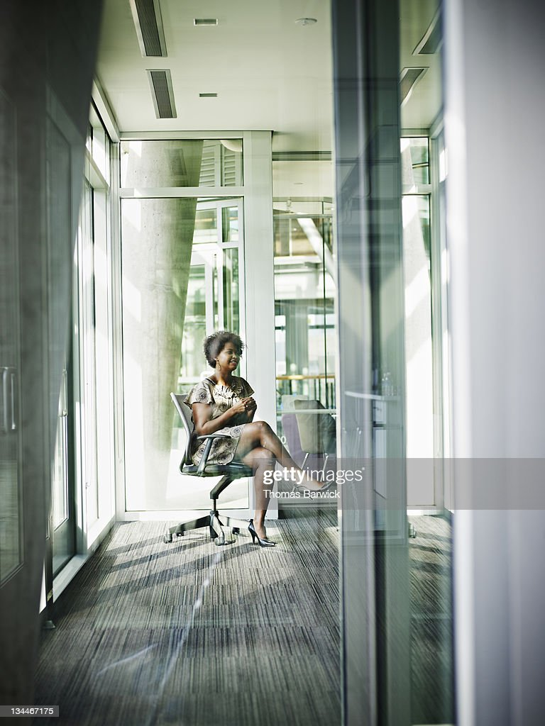 Businesswoman in discussion with coworker : Stock Photo