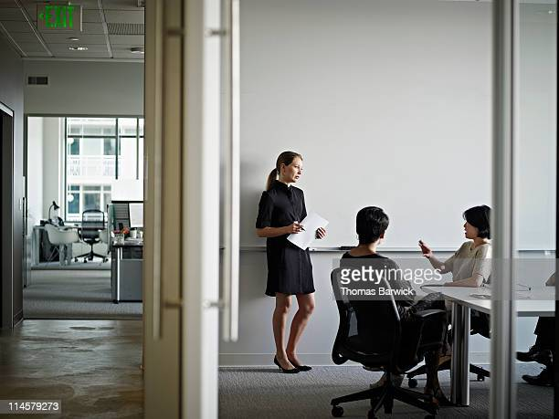 Businesswoman in discussion with coworkers