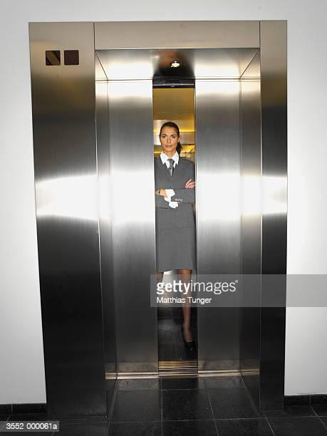 Businesswoman in Elevator