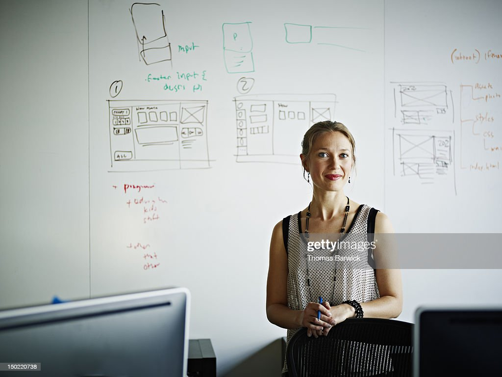Businesswoman in front of white board in office : Stock Photo