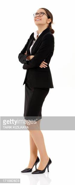 businesswoman in happily looking up the blank space