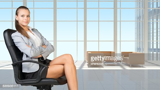 Businesswoman in headset, interior with transparent wall : Stock Photo