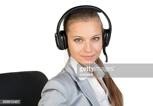 Businesswoman in headset sitting on chair : Stock Photo