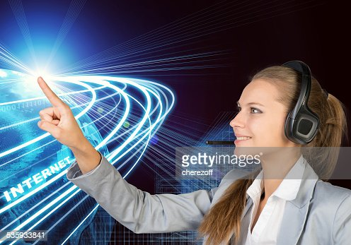 Businesswoman in headset touching or pressing something : Stock Photo