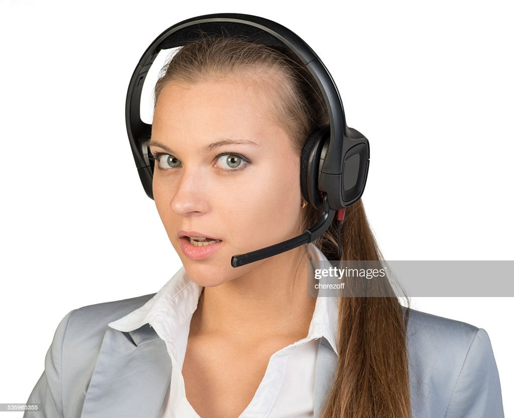Businesswoman in headset with her head half-turned to right : Stock Photo