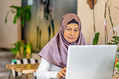 businesswoman in hijab working with Laptop