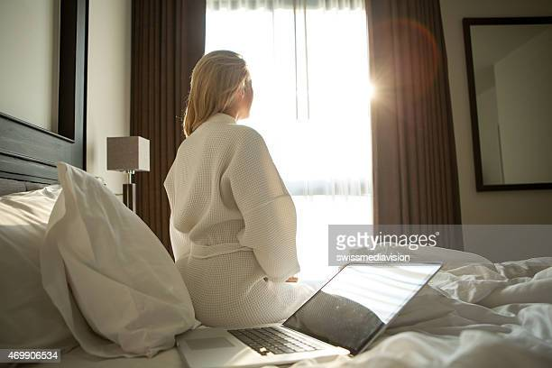 Businesswoman in hotel room, morning