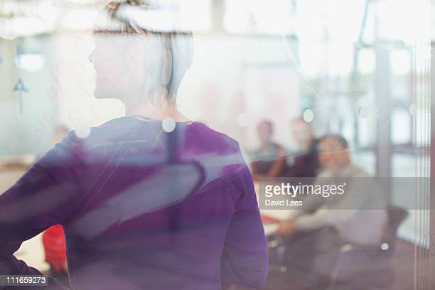 Businesswoman in meeting, rear view