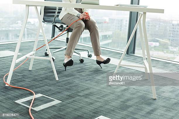 Businesswoman in new office holding cable