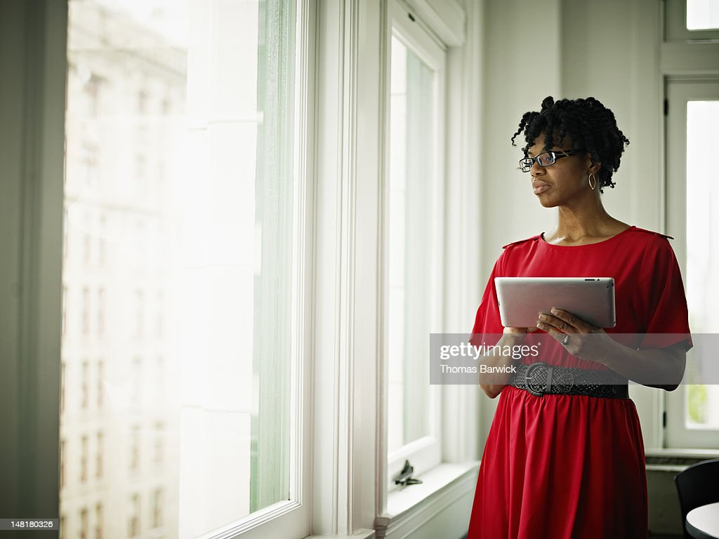 Businesswoman in office holding digital tablet : Stock Photo