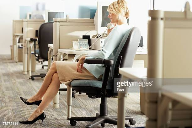 Businesswoman in Office on Phone