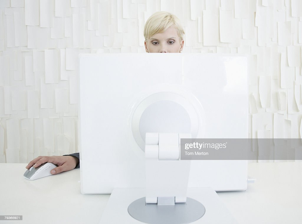 Businesswoman in office sitting at computer : Stock Photo