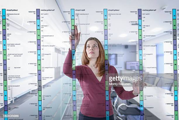 Businesswoman in office using interactive screen