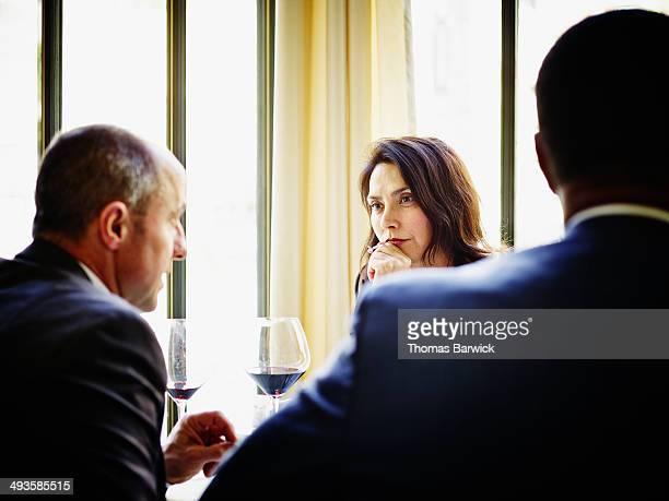 Businesswoman in restaurant listening to client