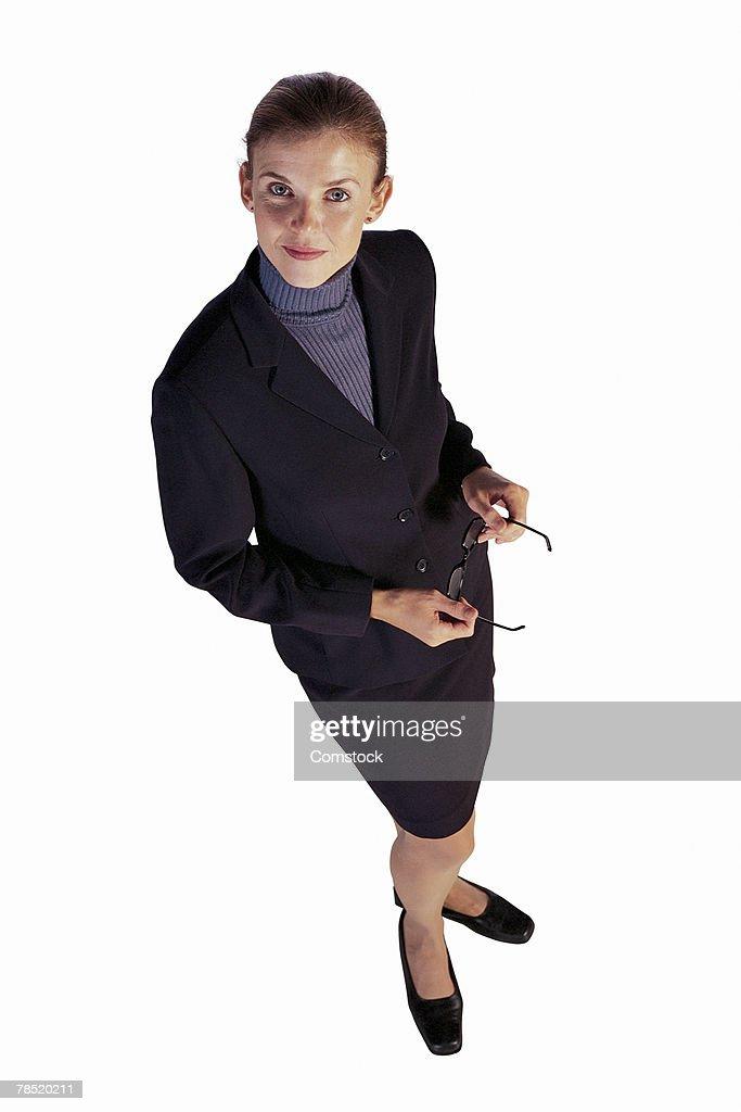 Businesswoman in skirt suit : Stock Photo