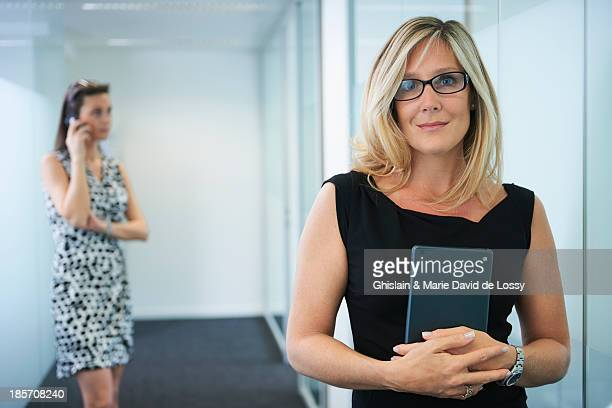 Businesswoman in the hall, holding tablet