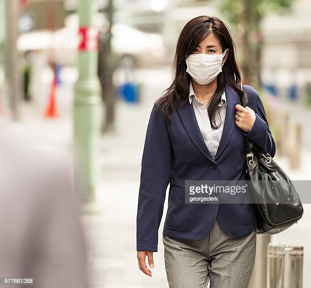 Businesswoman in Tokyo wearing protective face-mask