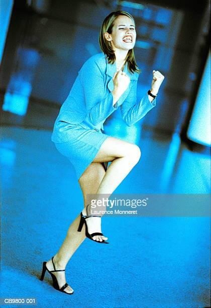 Businesswoman in triumphant pose