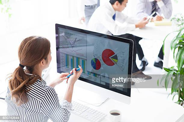 Businesswoman is making meeting materials on your computer