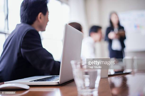 Businesswoman is the presentation in a conference room.