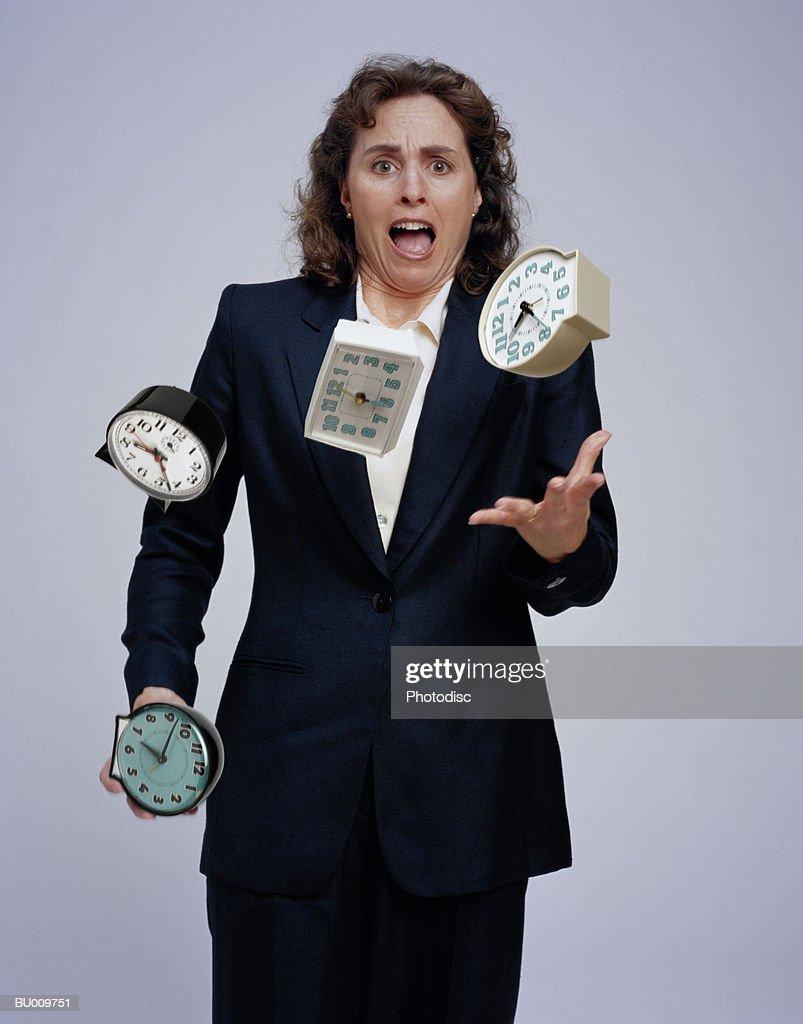 Businesswoman Juggling Clocks : Stock Photo