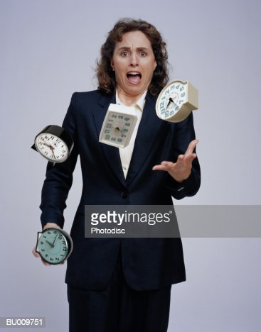 Businesswoman Juggling Clocks : Foto de stock