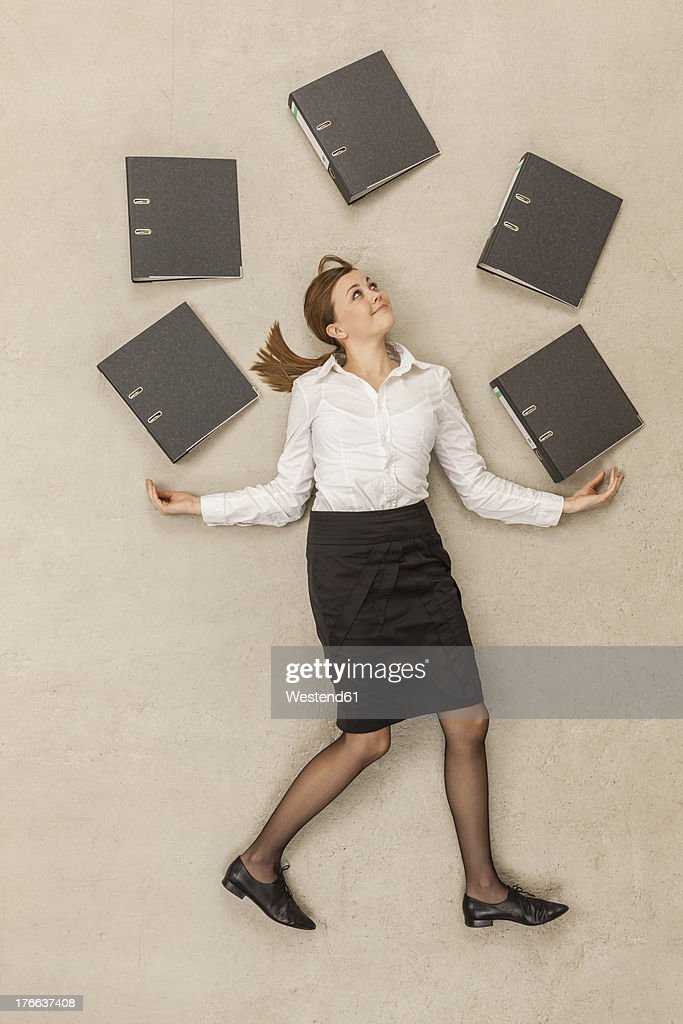 Businesswoman juggling with files