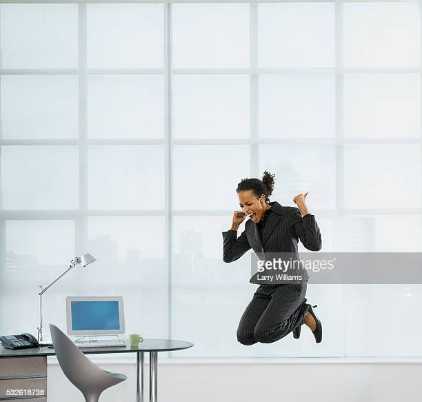 Businesswoman Jumping for Joy