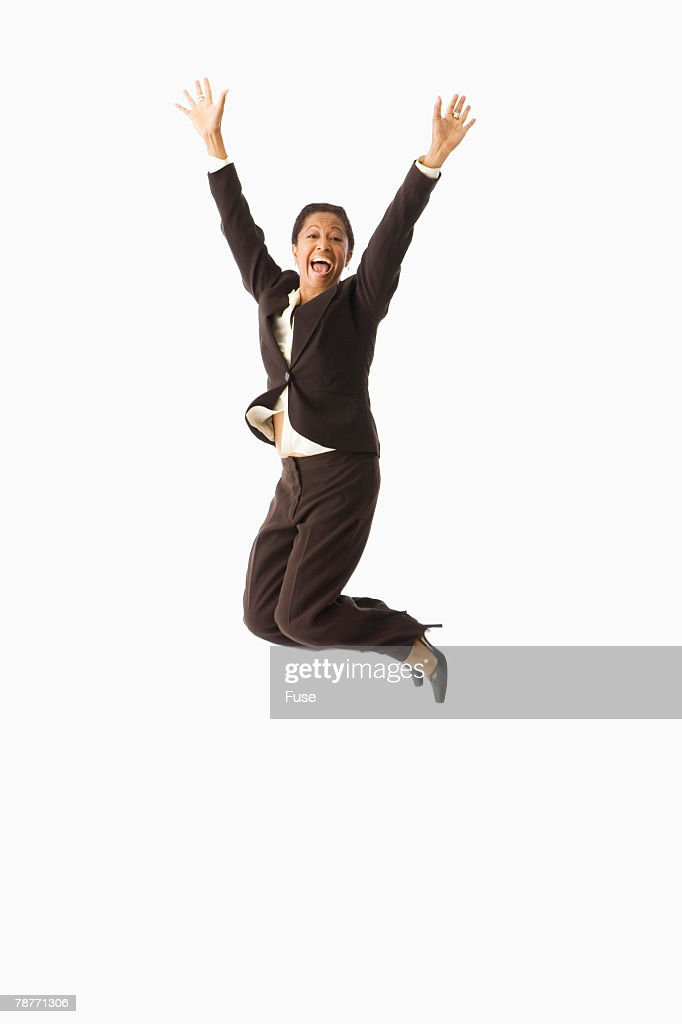 businesswoman jumping for joy stock photo getty images