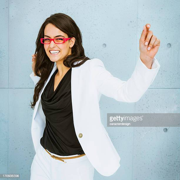 Businesswoman laughing and dancing