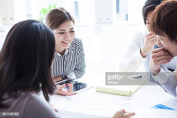 Businesswoman laughing during a meeting