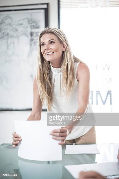 Businesswoman leading a meeting in conference room