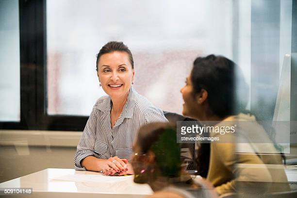 Businesswoman leading a meeting.