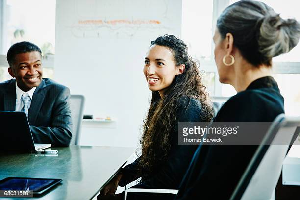Businesswoman leading discussion during meeting