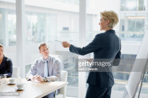Businesswoman leading discussion in meeting : Stock Photo