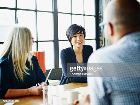 Businesswoman leading discussion with colleagues