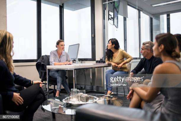 Businesswoman leading meeting in the office