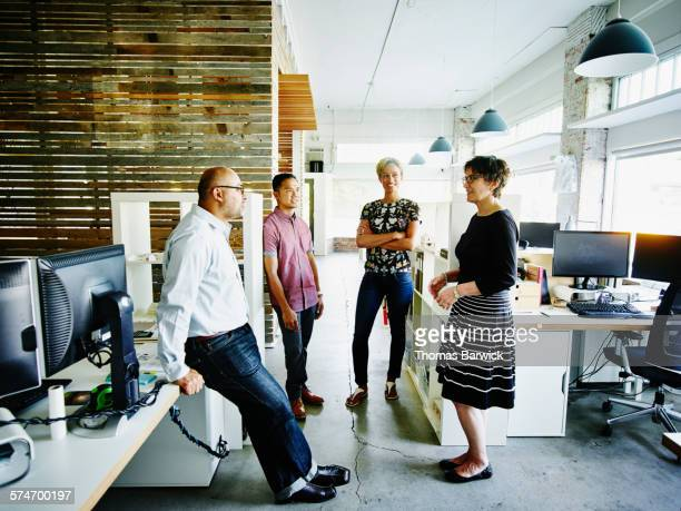 Businesswoman leading team meeting in office