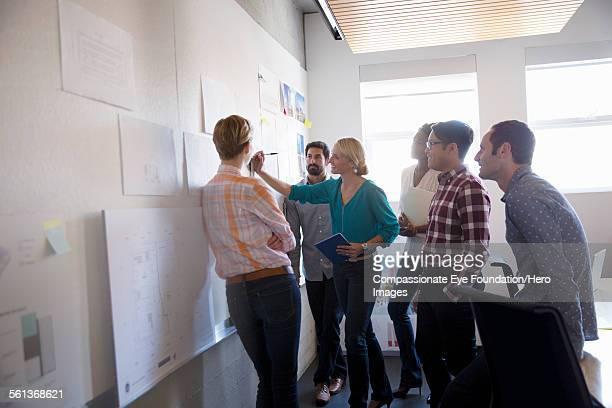 Businesswoman leading team meeting