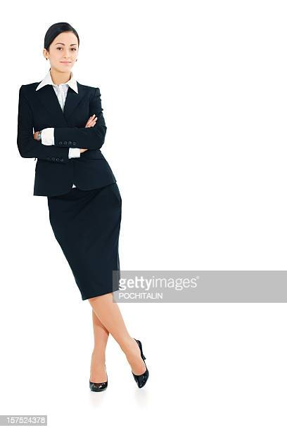Businesswoman leaning against white background