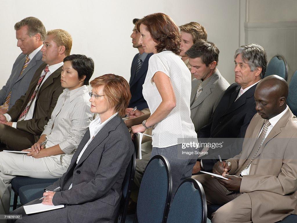 Businesswoman leaving presentation : Stock Photo