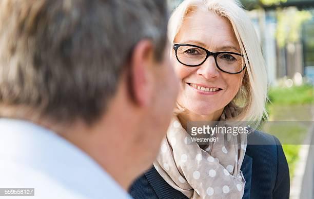 Businesswoman listening to businessman