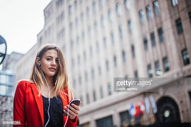 Businesswoman listening to music
