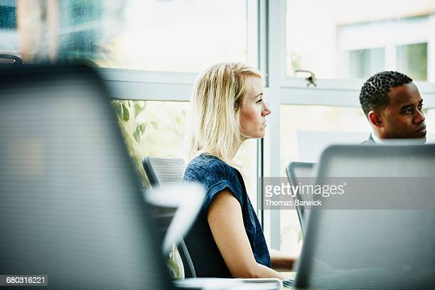 Businesswoman listening to presentation
