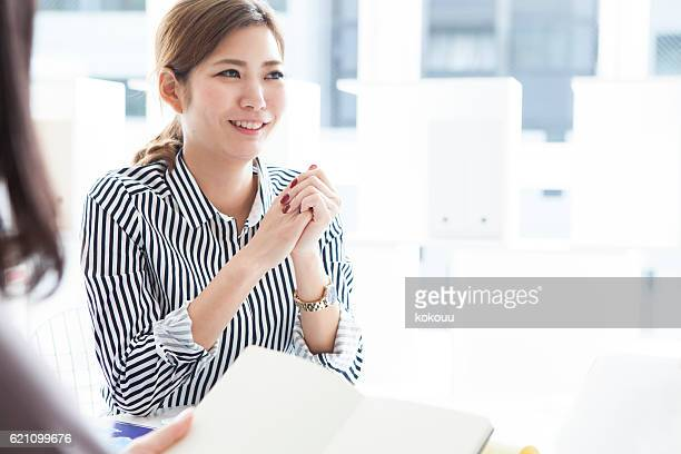 Businesswoman listening to the opinion of the boss during meeting