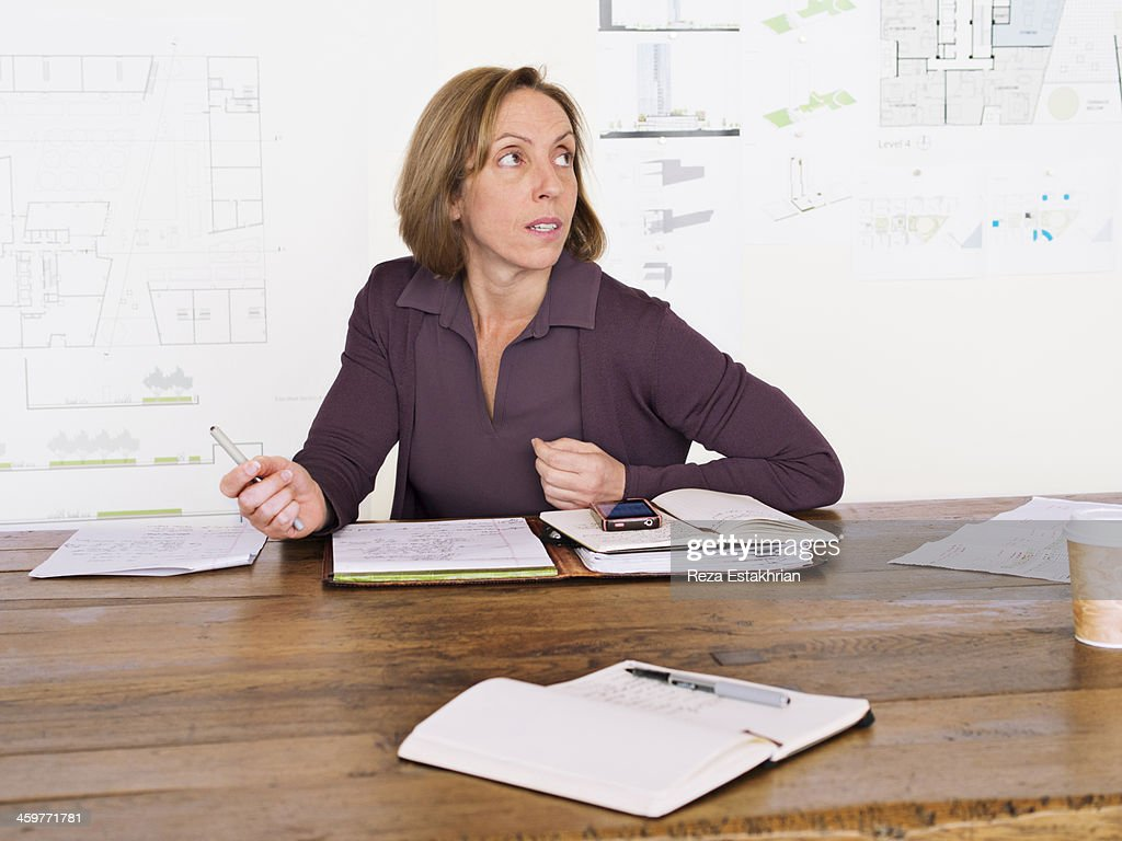 Businesswoman listens to colleague : Stock Photo