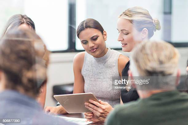 Businesswoman looking at a digital tablet on a meeting