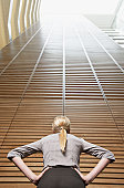 Businesswoman looking at atrium wall