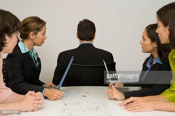 Businesswoman Looking at Businessman Sitting Backwards