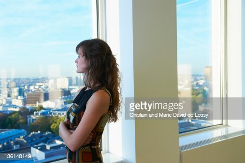 Businesswoman looking at cityscape : Stock Photo